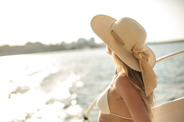 Woman looking out from a boat