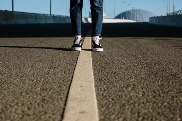 standing over a dividing line